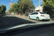 Pintadas sobre el auto de Carlos Torres